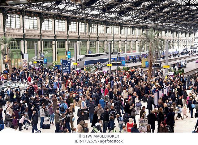 People waiting inside the Lyon Railway station, Paris, France, Europe