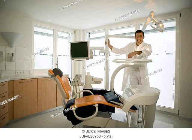 Male dentist and dentistis chair