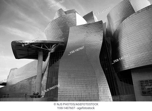 """Facade of Guggenheim Museum and """"Tulips"""" sculpture by Jeff Koons, Bilbao, Vizcaya, Basque Country, Spain, Europe"""