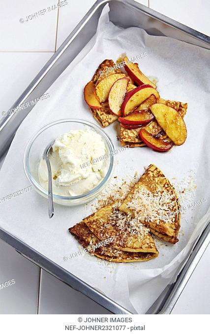 Pancakes with peach and ice cream