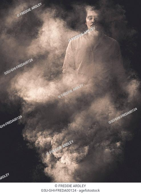 Man with Closed Eyes Standing Behind Smoke
