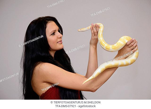 woman and Albino Burmese python