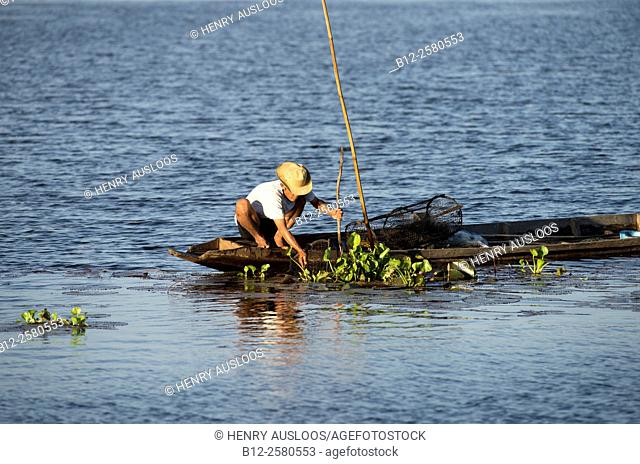 Fisherman in Southern Thailand with fish-traps