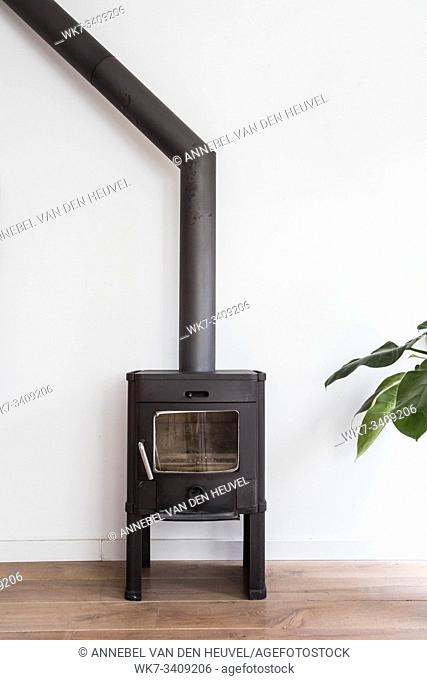 iron fireplace like a stove in a house with fire, scandinavian interior modern design, white room empty