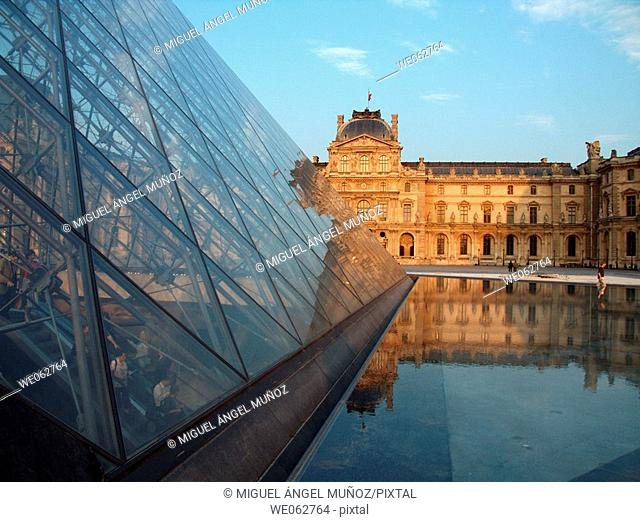Louvre Pyramid and Museum at sunset. Paris. France