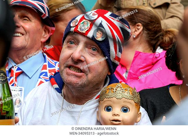 Royal fans outside Lindo Wing of St Mary's Hospital in Paddington toasts as the Duchess of Cambridge give birth to a baby boy Featuring: John Loughrey Where:...