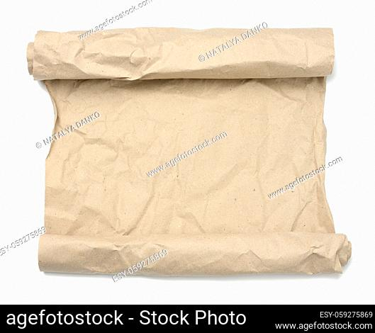 rolled roll of brown crumpled paper on white background, copy space