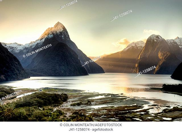 Mitre peak at sunset from above village, Milford Sound, Fiordland National Park, World Heritage site