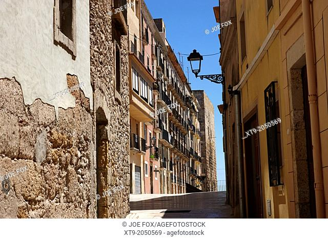 old medieval narrow streets leading to roman ruins on site of old circus tarragona catalonia spain