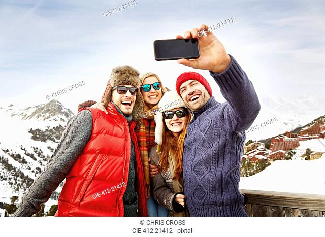Friends taking picture together in the snow