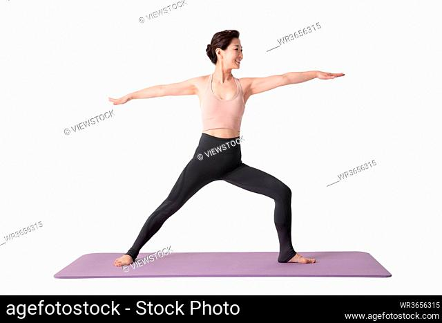 Middle-aged and old women practicing yoga
