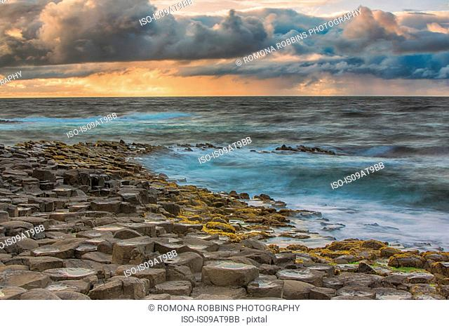 High angle view of Giants Causeway, ocean and dramatic sky, Bushmills, County Antrim, Ireland, UK