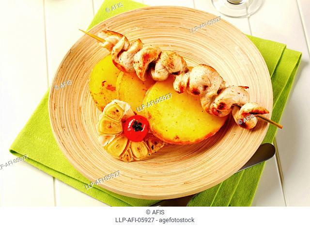 Chicken souvlaki and roasted potatoes
