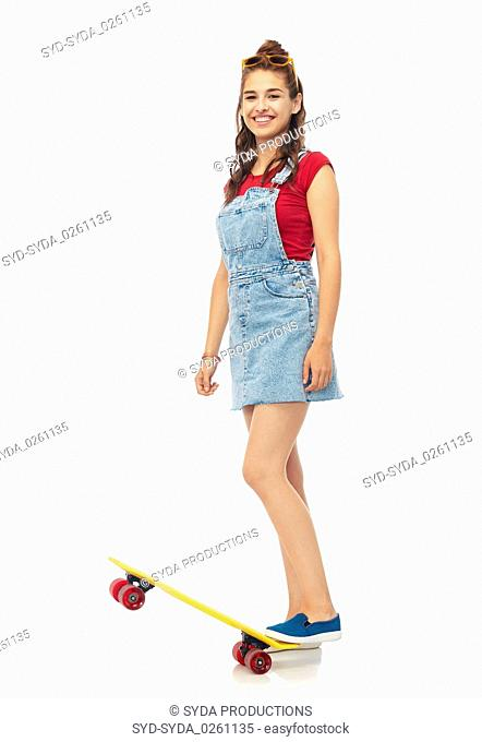 smiling teenage girl with skateboard over white