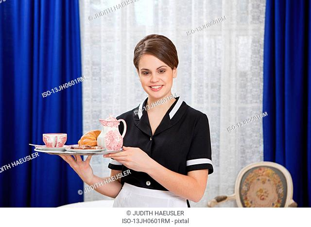 room maid with tray, laughing