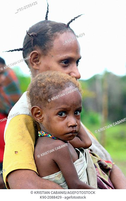 Mother carrying her kid, Papua, Indonesia, Southeast Asia