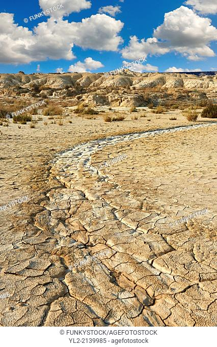 Rock formations and dried cracked mud in the Bardena Blanca area of the Bardenas Riales Natural Park, Navarre, Spain