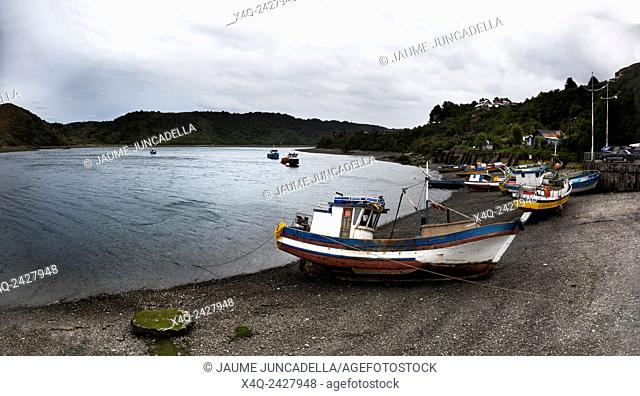 Fishing boats moored in Angelmo, tourist area and restaurant specialists in cooking fish