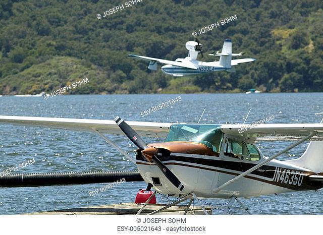 Two Amphibious seaplane landing on Lake Casitas, Ojai, California