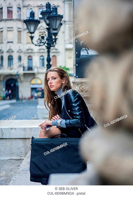 Woman looking bored on morning commute, Budapest, Hungary