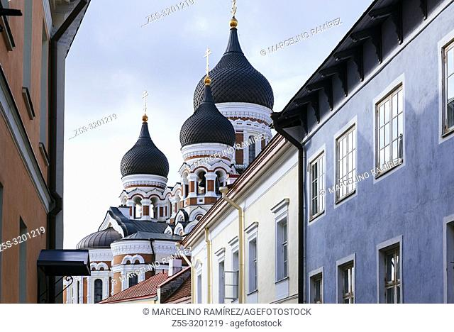 The onion domes of Alexander Nevsky Cathedral peek through the rooftops. Tallinn, Harju County, Estonia, Baltic states, Europe