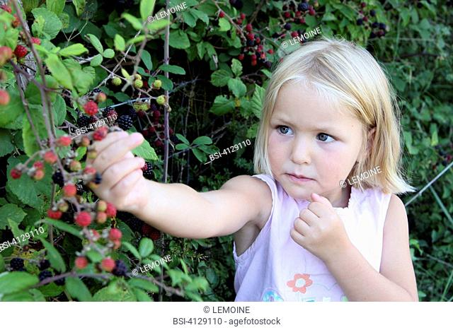 CHILD EATING FRUIT