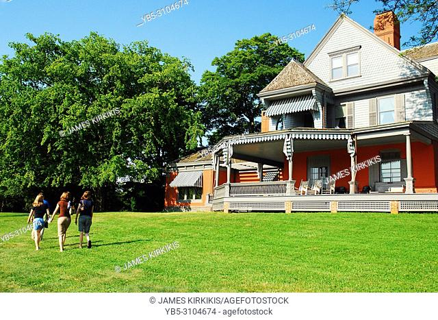 A family strolls the grounds of Sagamore Hill, President Teddy Roosevelt's home in Oyster Bay, New York