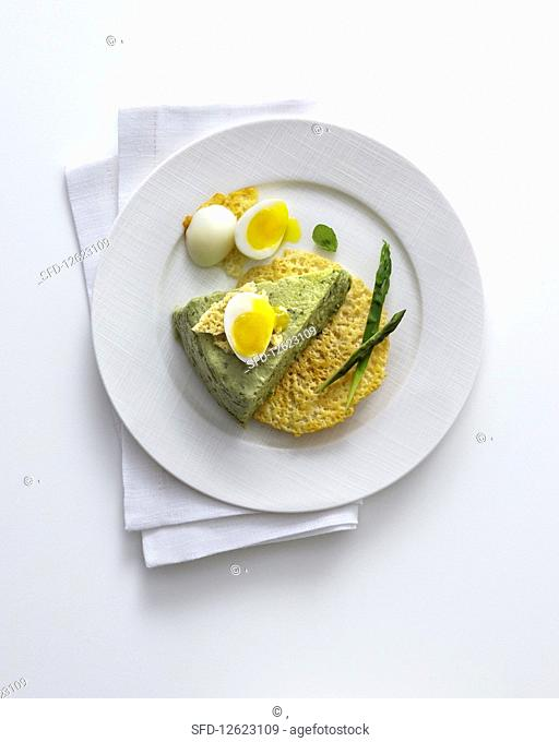 Green asparagus and basil flan on Parmesan crisps with quail's eggs