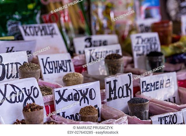 Beautiful vivid oriental market with bags full of various spices in Osh bazaar in Bishkek, Kyrgyzstan