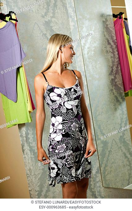 Young woman trying dress on