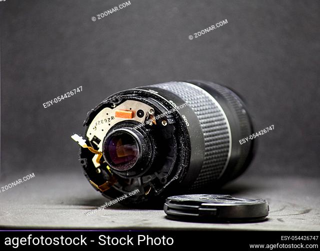 part of camera lens isolated on black background broken camera