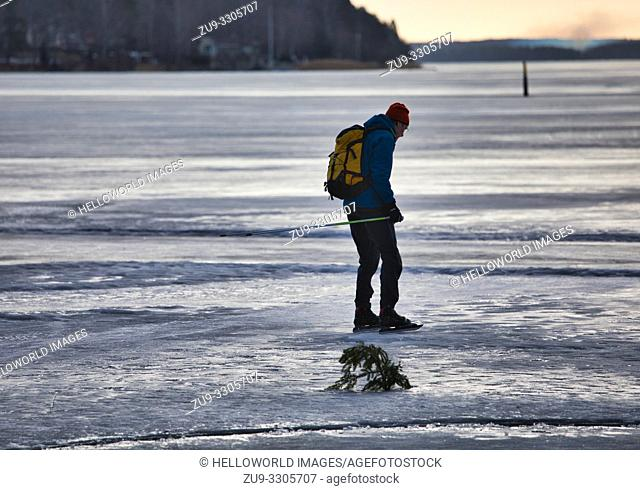 Long distance ice skater alone on Lake Malaren, Sweden, Scandinavia