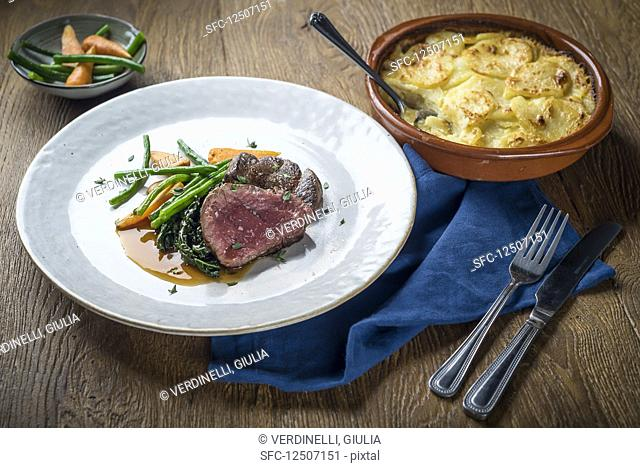 Roast beef with vegetables and potato gratin