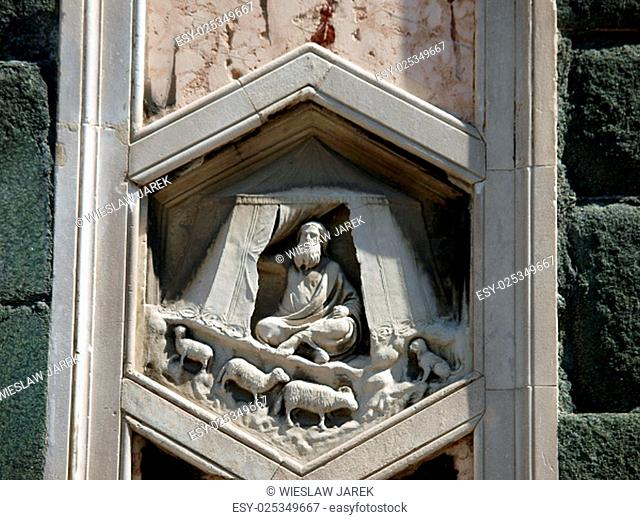Florence - The hexagonal Relief on the Giottos' Campanile.The hexagonal panels on the lower level depict the history of mankind, inspired by Genesis