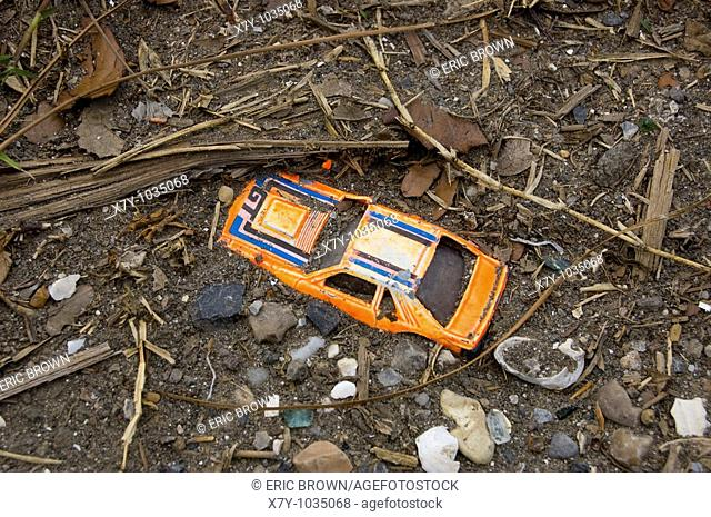 A partially buried toy car seen in Lower Ninth Ward, 9 months after the flooding of Hurricane Katrina, New Orleans, LA, USA