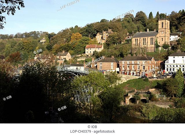 England, Shropshire, Ironbridge , The Ironbridge Gorge and town beyond. The Ironbridge Gorge is known throughout the world as the birthplace of the Industrial...