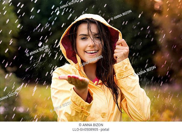 Pretty young woman in yellow raincoat Debica, Poland