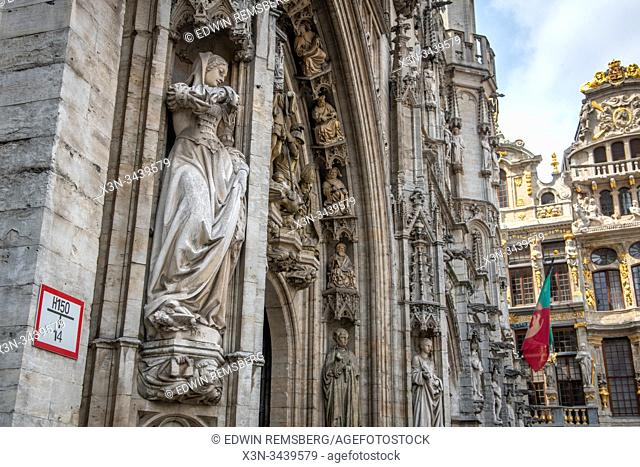 Gothic style statues on the facade of buildings in the Grand Place, , Brussels, Belgium