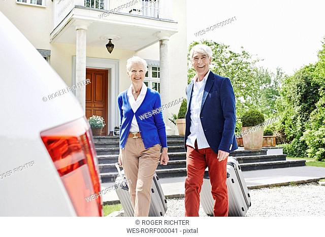 Germany, Hesse , Frankfurt, Senior couple preparing for travel