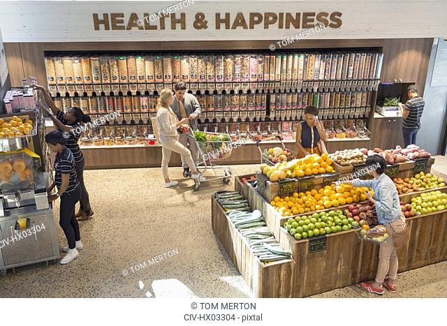 View of people grocery shopping in health food store