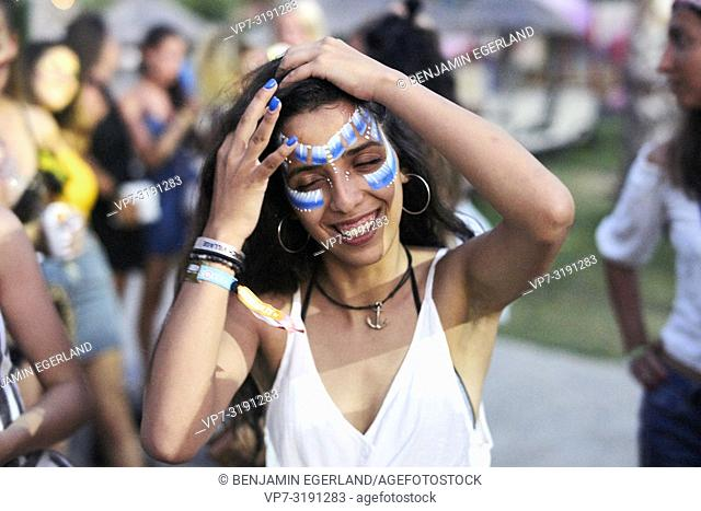 woman with face paint, at Tribal Beach Party at Starbeach Chersonissos, Crete, Greece, on 31. July 2018