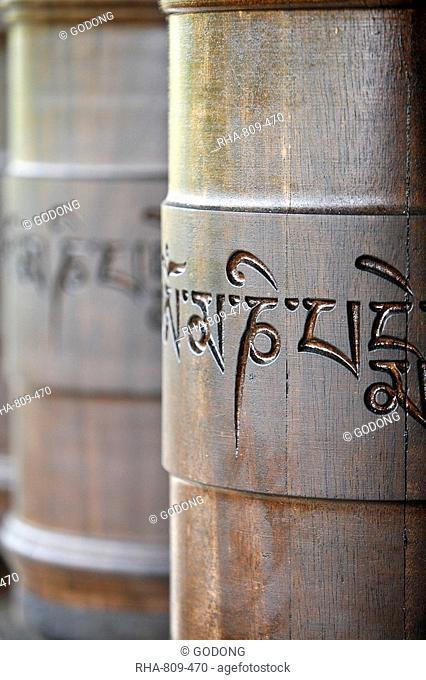 Prayer wheels in Dhagpo Kagyu Ling Tibetan Buddhist monastery, Saint-Leon sur Vezere, Dordogne, France, Europe