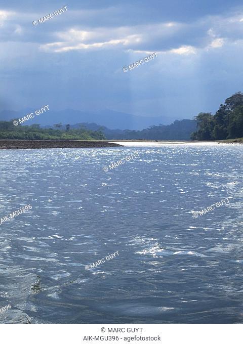 Dark rain clouds over the Alto Madre de Dios River in the Lower Amazon rainforest in Madre de Dios department in Peru