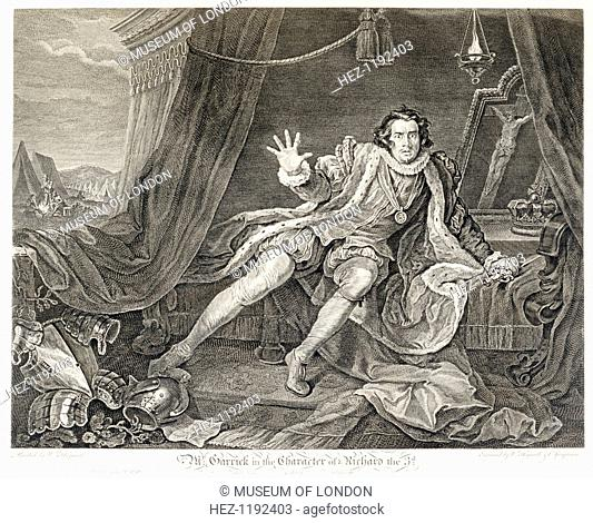 The actor David Garrick in the role of Richard III, 1746. He wildly stares out at the viewer with a dagger in one hand. He sits before a crucifix and his crown
