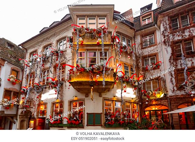 Traditional Alsatian half-timbered house in old town of Strasbourg, decorated at christmas time, Alsace, France