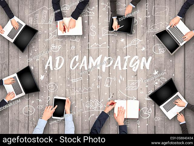 Group of business people working in office with AD CAMPAIGN inscription, coworking concept