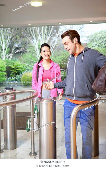 Couple walking through turnstile