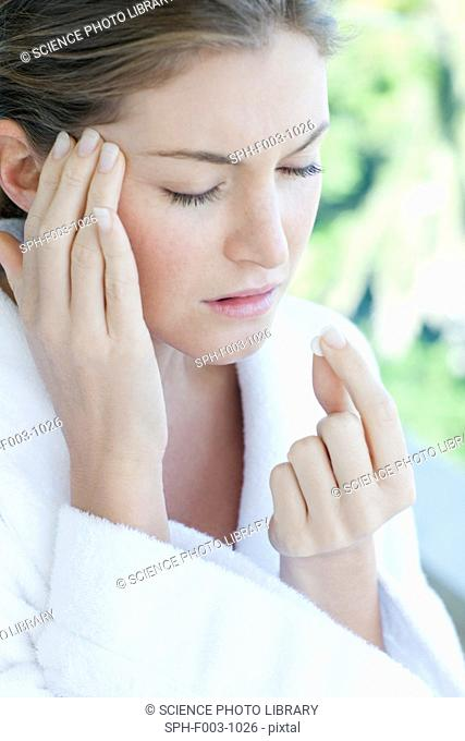 Woman taking painkillers