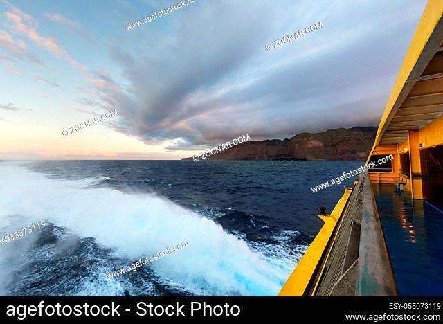 Clouds at dusk at sea from cruise ship railing