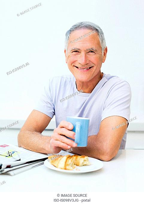 Senior man having breakfast